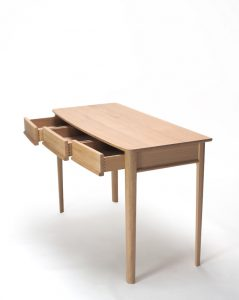 An oak dressing table with textured surfaces